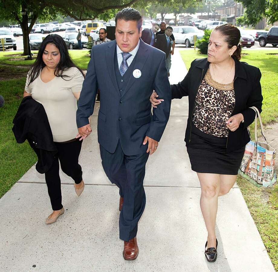 David Barajas, charged with murder, walks with wife, Cindy, left, and stepmother, Betty Hernandez, into court in Angleton.  Photo: Thomas B. Shea, Freelance / © 2014 Thomas B. Shea