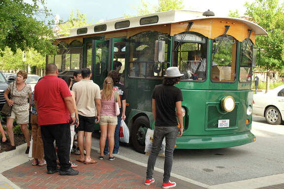 The Town Center trolley picks up customers on Market Street in the Town Center Improvement District. The Woodlands hopes to soon reduce passengers' wait times by more than half.