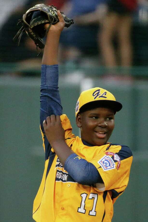 Chicago pitcher Joshua Houston pulls on his sleeves during the first inning against Pearland during an elimination baseball game at the Little League World Series in South Williamsport, Pa., Tuesday, Aug. 19, 2014. Chicago won 6-1. (AP Photo/Gene J. Puskar) Photo: Gene J. Puskar, Associated Press / AP