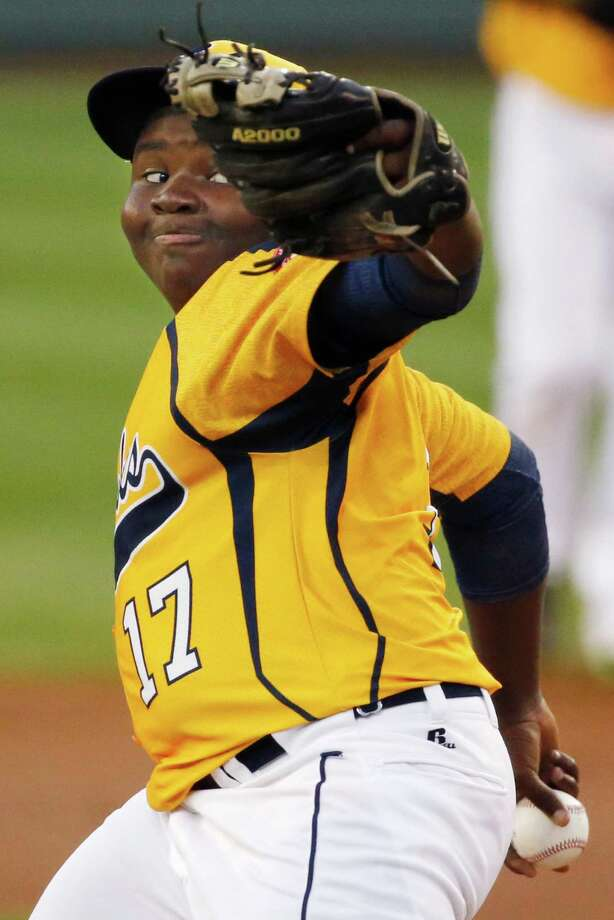 Chicago pitcher Joshua Houston delivers during the first inning against Pearland during an elimination baseball game at the Little League World Series tournament in South Williamsport, Pa., Tuesday, Aug. 19, 2014. Chicago won 6-1. (AP Photo/Gene J. Puskar) Photo: Gene J. Puskar, Associated Press / AP