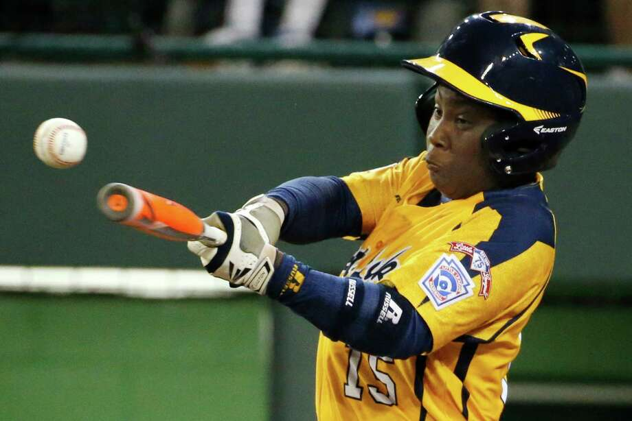 Chicago's Darion Radcliff (15) drives in a run with a single off Pearland pitcher Walter Maeker III in the fourth inning inning of an elimination baseball game at the Little League World Series in South Williamsport, Pa., Tuesday, Aug. 19, 2014. Chicago won 6-1. (AP Photo/Gene J. Puskar) Photo: Gene J. Puskar, Associated Press / AP