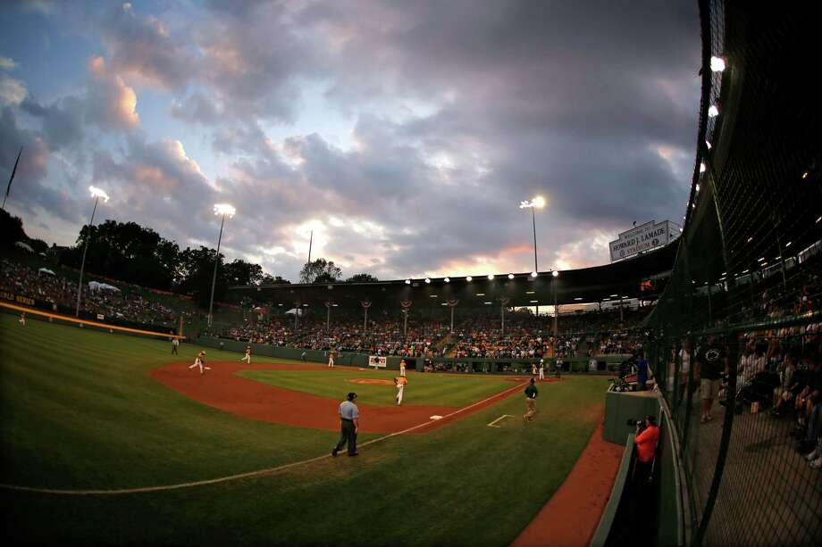 The sunsets over Lamade Stadium during an elimination baseball game between Chicago and  Pearland at the Little League World Series tournament in South Williamsport, Pa., Tuesday, Aug. 19, 2014. Chicago won 6-1. (AP Photo/Gene J. Puskar) Photo: Gene J. Puskar, Associated Press / AP