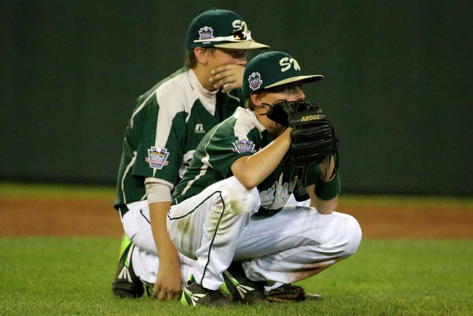 Pearland first baseman Layne Roblyer, rear, and second baseman Brandon Sliwinski wait during a pitching change in the fifth inning of an elimination baseball game against Chicago at the Little League World Series tournament in South Williamsport, Pa., Tuesday, Aug. 19, 2014. Chicago won 6-1. (AP Photo/Gene J. Puskar) Photo: Gene J. Puskar, Associated Press / AP