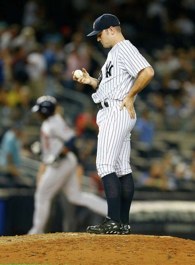 NEW YORK, NY - AUGUST 19: David Robertson #30 of the New York Yankees looks on after giving up a three run home run in the ninth inning to Chris Carter #23 of the Houston Astros at Yankee Stadium on August 19, 2014 in the Bronx borough of New York City.  (Photo by Mike Stobe/Getty Images) ORG XMIT: 477588283 Photo: Mike Stobe / 2014 Getty Images
