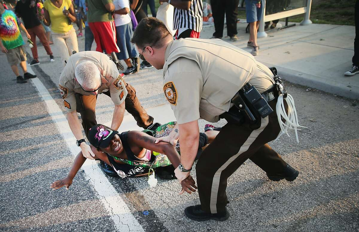 FERGUSON, MO - AUGUST 19: A demonstrator is arrested while protesting the killing of teenager Michael Brown on August 19, 2014 in Ferguson, Missouri. Brown was shot and killed by a Ferguson police officer on August 9. Despite the Brown family's continued call for peaceful demonstrations, violent protests have erupted nearly every night in Ferguson since his death. (Photo by Scott Olson/Getty Images)