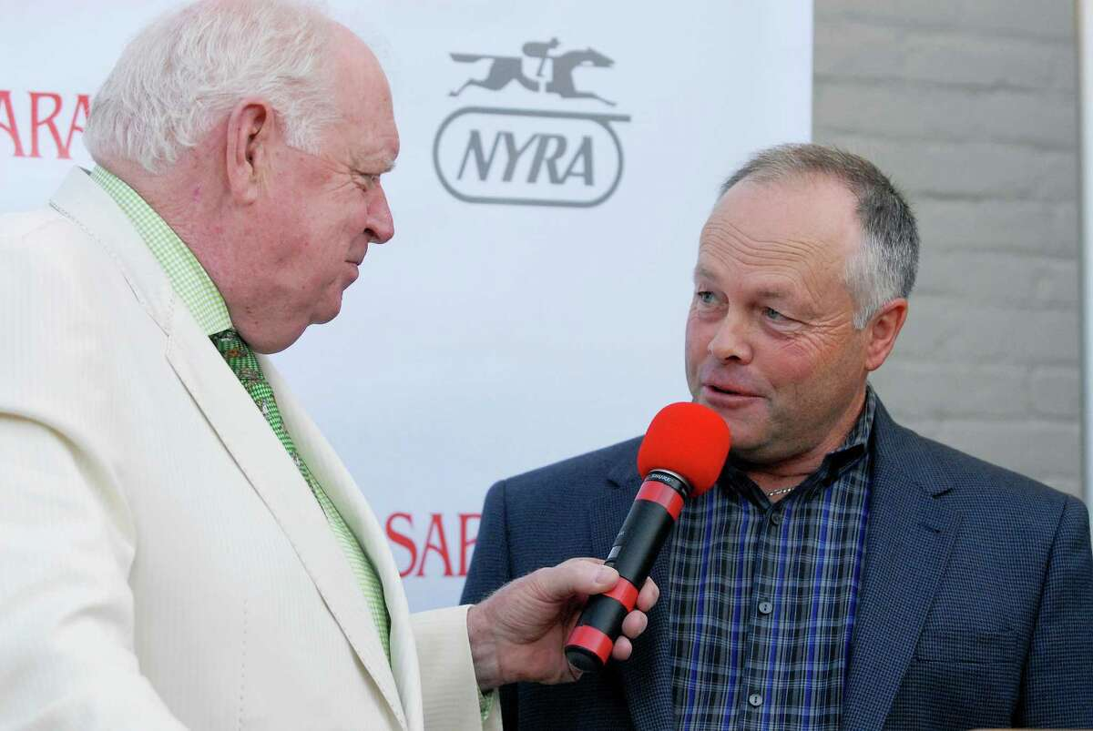 Race caller Tom Durkin interviewed trainer Ian Wilkes who will be running Ulanbator at the press conference for the Saratoga Race Course Travers Draw, which will be held this Saturday August 23rd, 2014. Thursday, Aug. 19, 2014, at Druthers in Saratoga Springs, N.Y. (Erica Miller/ Special to the Times Union)