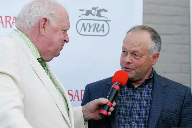 Race caller Tom Durkin interviewed trainer Ian Wilkes who will be running Ulanbator at the press conference for the Saratoga Race Course Travers Draw, which will be held this Saturday August 23rd, 2014.             Thursday, Aug. 19, 2014, at Druthers in Saratoga Springs, N.Y. (Erica Miller/ Special to the Times Union) Photo: Erica Miller /  ©Tom Brenner/ Albany Times Union