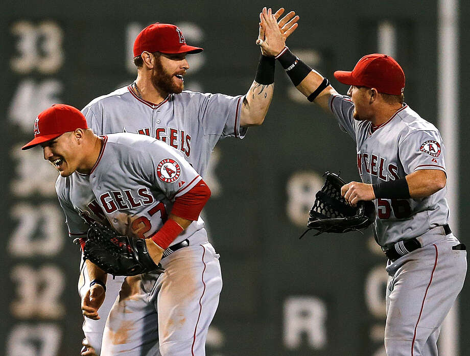 Angels Josh Hamilton (back left), Kole Calhoun (right) and Mike Trout enjoy their win in Boston. Photo: Jim Rogash / Getty Images / 2014 Getty Images