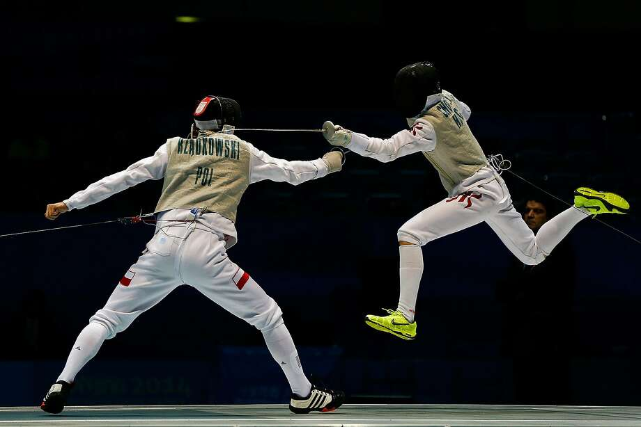 NANJING, CHINA - AUGUST 19:  Chun Yin Ryan Choi of Hong Kong (L) and Andrzej Rzadkowski of Poland compete in the Women's Sabre Individual Final on day three of the Nanjing 2014 Summer Youth Olympic Games at Nanjing International Expo Centre on August 19, 2014 in Nanjing, China.  (Photo by Lintao Zhang/Getty Images) *** BESTPIX *** Photo: Lintao Zhang, Getty Images
