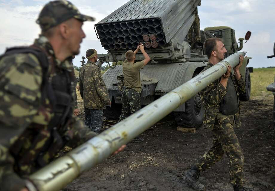 TOPSHOTS Ukrainian soldiers charge a Grad multiple rocket launcher system, near the eastern Ukrainian city of Shchastya, Lugansk region, on August 18, 2014. Ukraine accused pro-Russian rebels of killing dozens of civilians fleeing the war-torn east on August 18, 2014 as crisis talks between Kiev and Moscow failed to halt months of bloodshed.  AFP PHOTO/  ALEKSEY CHERNYSHEVALEKSEY CHERNYSHEV/AFP/Getty Images Photo: Aleksey Chernyshev, AFP/Getty Images