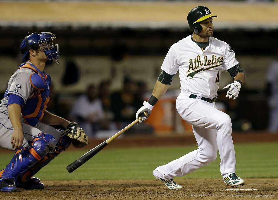 Coco Crisp lashes a triple in the fourth inning, scoring three runs for a 4-1 lead. Photo: Ben Margot, Associated Press
