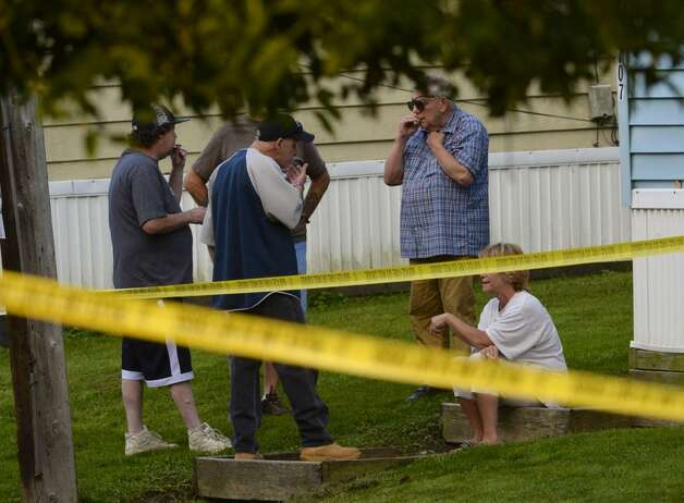 Troy police were at 709 First Ave., on Wednesday to investigate the deaths of two people who were brutally beaten inside the trailer home that abuts the Hudson River.  (Skip Dickstein / Times Union)
