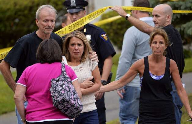A relative of two people who were found beaten to death inside a home at 709 First Ave., arrived at the scene Wednesday morning.  (Skip Dickstein / Times Union)