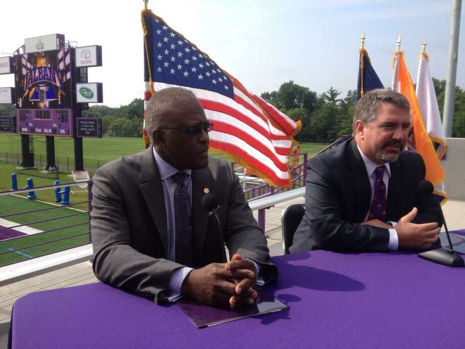 Mark Benson, right, was named new Athletic Director at the University at Albany by President Robert Jones. (Cindy Schultz/Times Union)