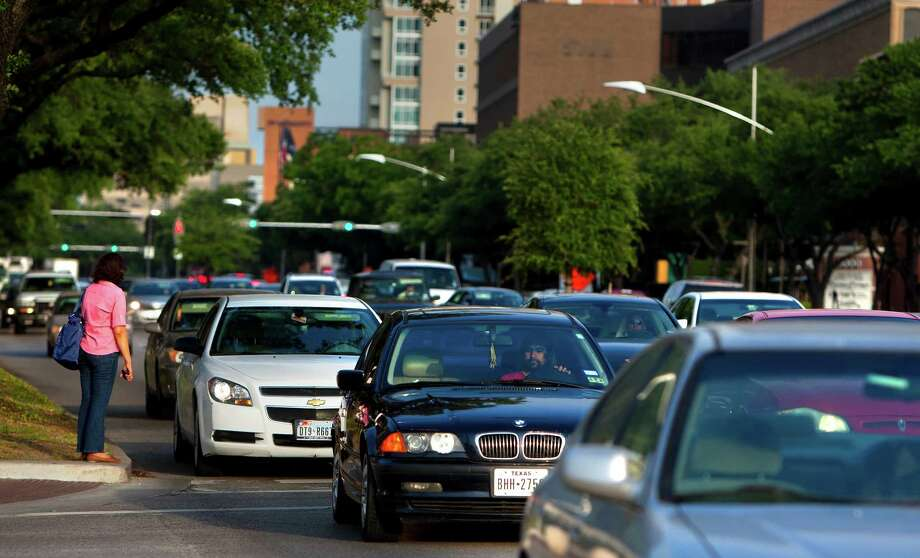 Uptown District leaders say bus rapid transit will ease congestion on Westheimer and Post Oak. Critics contend bus lanes will only make the corridor worse at a pricey expense. Photo: Cody Duty, Staff / © 2013 Houston Chronicle