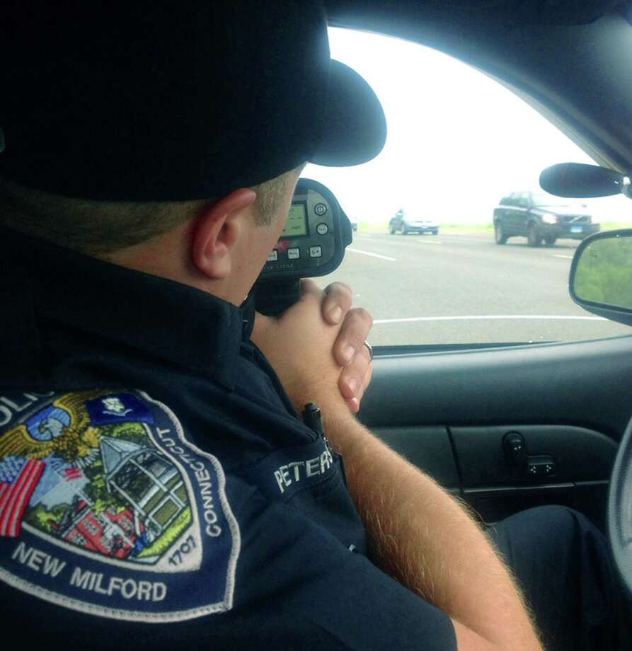 Officer David Petersen of the New Milford Police Department checks the speed of passing vehicles, August 2014 Photo: Susan Tuz / The News-Times