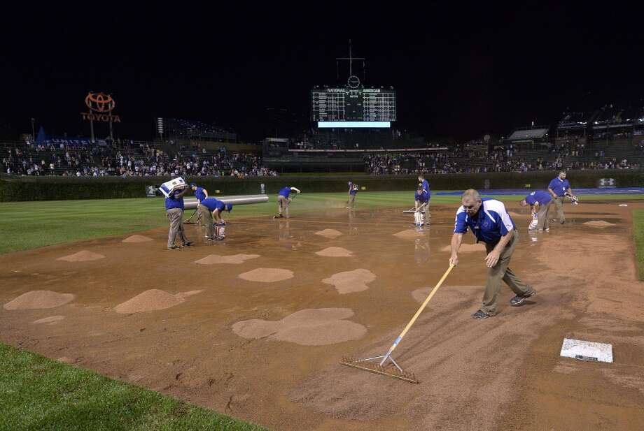 Chicago Cubs head groundskeeper Roger Baird (right) and the crew work on Wrigley Field. Photo: Brian Kersey, Getty Images