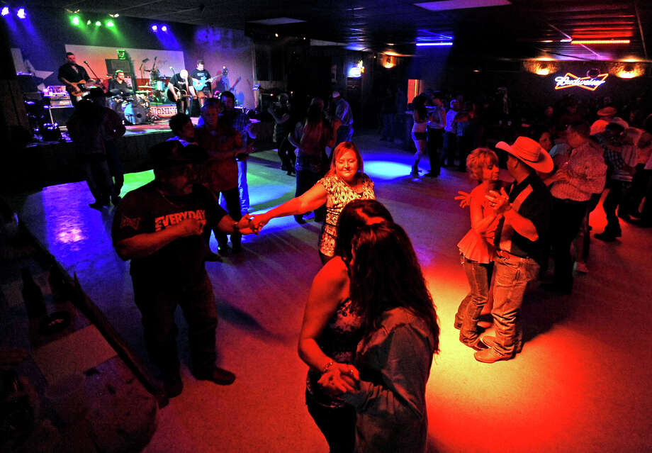 Couples swarm the dance floor at the Roger Creager concert at Honky Tonk Texas in Silsbee on Friday, July 19, 2013.  Photo taken: Randy Edwards/The Enterprise Photo: Randy Edwards