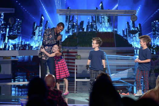 AMERICA'S GOT TALENT -- Episode 916 -- Pictured: (l-r) Nick Cannon, Dom The Bom's Triple Threat-- (Photo by: Virginia Sherwood/NBC) Photo: NBC, Virginia Sherwood/NBC / 2014 NBCUniversal Media, LLC.