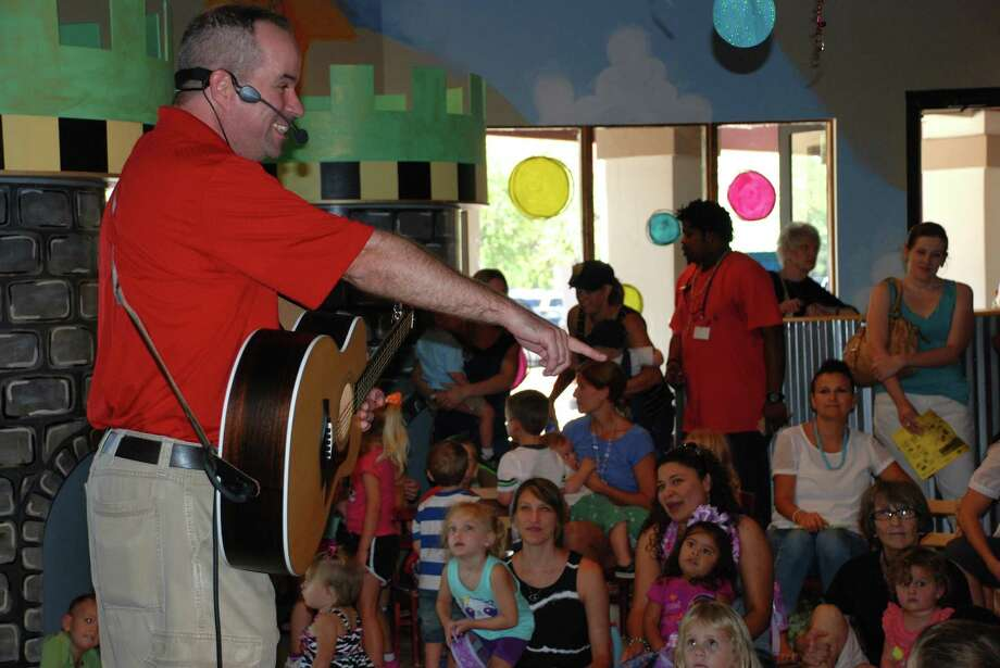 "It's the last bash of the summer at the Woodland's Children's Museum. ""Shake Your Summer Sillies Out"" begins with a reading of ""The Juice Box Bully"" and festivities will include kid-friendly rocker Any Roo, Tom's Fun Band (pictured) and comic juggler Claude Sims. Other activities include making silly hats, creating a friendship bracelet, balloon ping pong and a cup-stacking contest. Activities are geared for ages 7 and younger. Photo: Courtesy Photo"