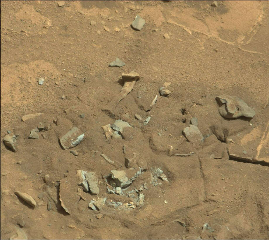 Bones on Mars?The space watchers at UFOblogger.com say this image shot by NASA's Curiosity rover on the surface of Mars shows what looks like a thigh bone. Can you see it? Photo: NASA