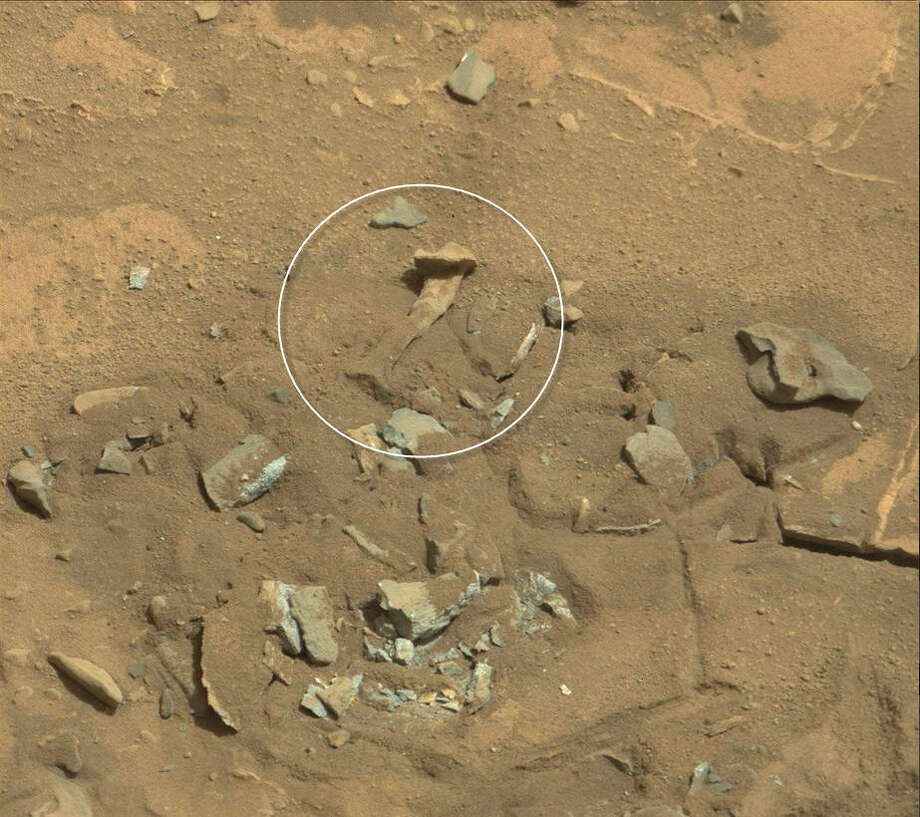 Bones on Mars? (Highlighted)  What about now?Check out these other dubious findings space-watchers have found in Mars rover images ... Photo: NASA