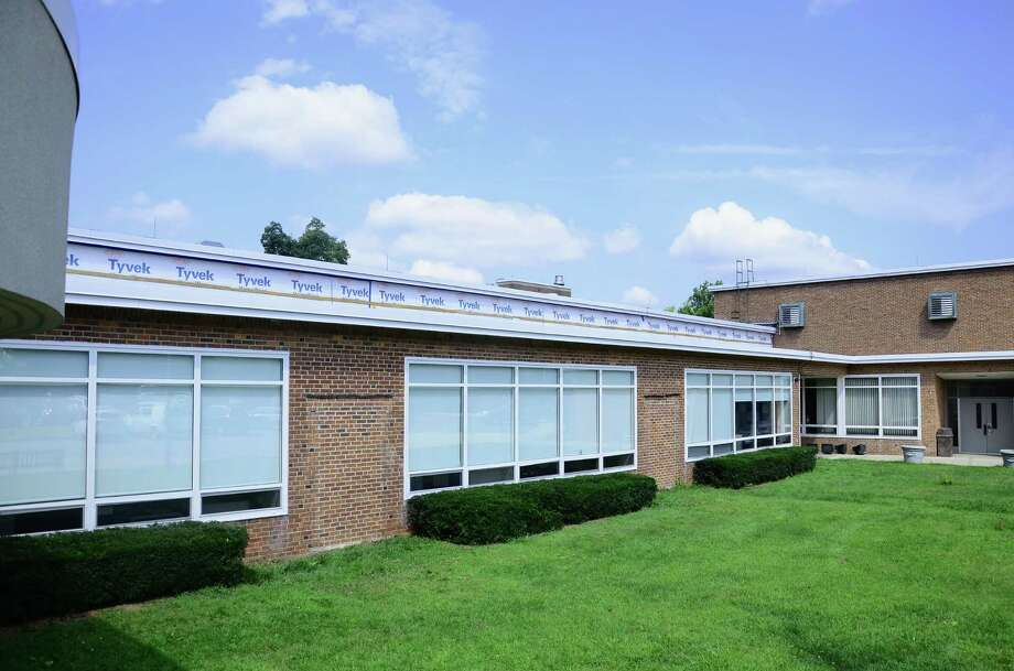 The upper level glass blocks at South Elementary School in New Canaan, Conn., have been removed and replaced with weather-proof boards as part of a window replacement project. Phase one of the project was completed Aug. 8, 2014, and phase two is scheduled to begin in summer 2015. Photo: Nelson Oliveira / New Canaan News