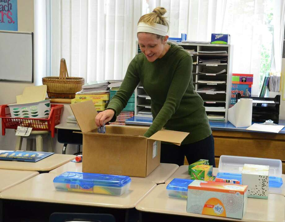 Second-grade teacher Katie Tiani unpacks school supplies, which were donated by the Parent-Teacher Council, at an East Elementary School classroom in New Canaan, Conn., on Wednesday, Aug. 20, 2014. Photo: Nelson Oliveira / New Canaan News