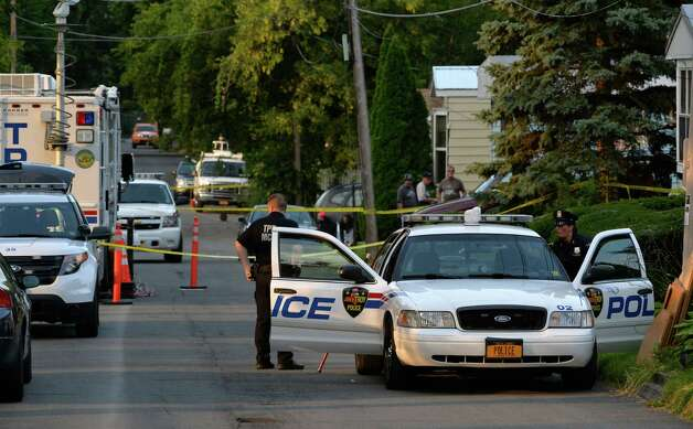 Troy police investigate a double homicide at 709 First Ave. Wednesday morning, Aug. 20, 2014, in Troy, N.Y. (Skip Dickstein/Times Union) Photo: SKIP DICKSTEIN