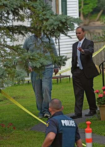 Rensselaer County First Assistant District Attorney Carmelo  Lacquidara, right, works the crime scene at a double homicide at 709  First Ave., Troy, Wednesday morning, Aug. 20, 2014 in Troy, N.Y. (Skip Dickstein/Times Union) Photo: SKIP DICKSTEIN