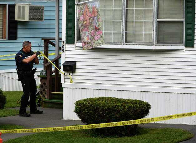 Troy police investigate a double homicide at 709 First Ave. Wednesday morning, Aug. 20, 2014 in Troy, N.Y. (Skip Dickstein/Times Union) Photo: SKIP DICKSTEIN