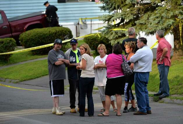 Family and friends arrive as Troy police investigate a double homicide at 709 First Ave. Wednesday morning, Aug. 20, 2014, in Troy, N.Y. (Skip Dickstein/Times Union) Photo: SKIP DICKSTEIN