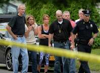 Family and friends arrive as Troy police investigate a double homicide at 709 First Ave. Wednesday morning, Aug. 20, 2014, in Troy, N.Y. (Skip Dickstein/Times Union)