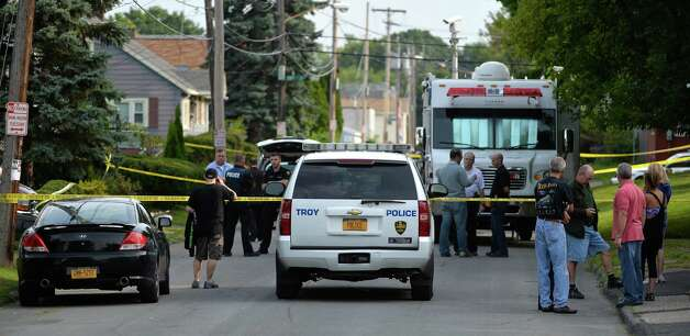 Troy police investigate a double homicide at 709 First Ave. Wednesday morning Aug. 20, 2014 in Troy, N.Y.      (Skip Dickstein/Times Union) Photo: SKIP DICKSTEIN