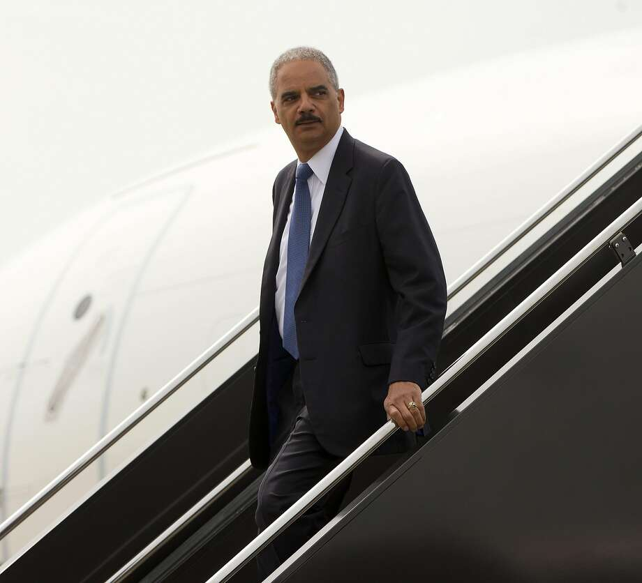 Attorney General Eric Holder arrives on US Military aircraft at Lambert-St. Louis International Airport in St. Louis, Wednesday, Aug. 20, 2014. Holder is traveling to Ferguson, Mo., to oversee the federal government's investigation into the shooting of 18-year-old Michael Brown by a police officer on Aug. 9th. Photo: Pablo Martinez Monsivais, Associated Press