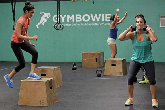 Laura Curry, right, of Houston and others participate in the Femme Fit class at GymBowie, 2222 Morgan, Thursday, Aug. 7, 2014, in Houston. ( Melissa Phillip / Houston Chronicle )