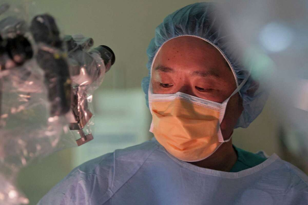 Dr. Dong Kim a neurosurgeon at Memorial Hermann is shown during an operation Wednesday, July 23, 2014, in Houston. ( Melissa Phillip / Houston Chronicle )
