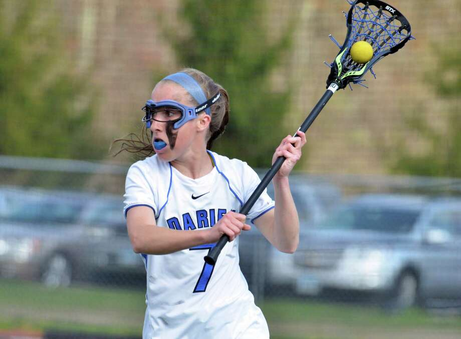 Darien's Mariah Matheis controls the ball during a girls lacrosse game against New Canaan at Darien High School on Friday, May 2. Photo: Amy Mortensen / Connecticut Post Freelance