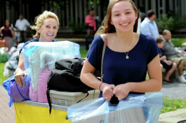 Julie Kantor of Poughkeepsie, left, helps her daughter, freshman Elizabeth Kantor, 18, move into her dorm room on Wednesday, Aug. 20, 2014, at University at Albany in Albany, N.Y. (Cindy Schultz / Times Union) Photo: Cindy Schultz / 10028085A