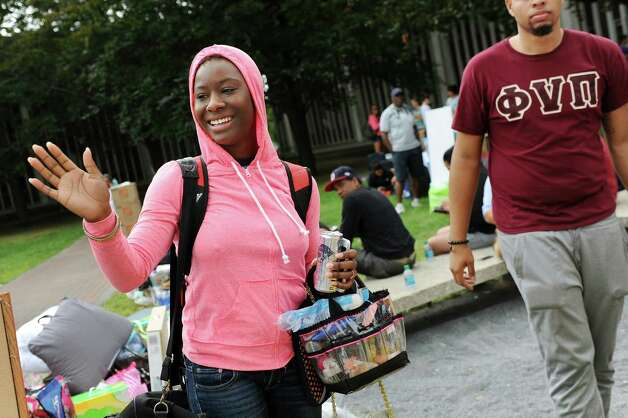 Freshman Shaneice Silvera, 18, left, spots a friend on moving in day on Wednesday, Aug. 20, 2014, at University at Albany in Albany, N.Y. (Cindy Schultz / Times Union) Photo: Cindy Schultz / 10028085A