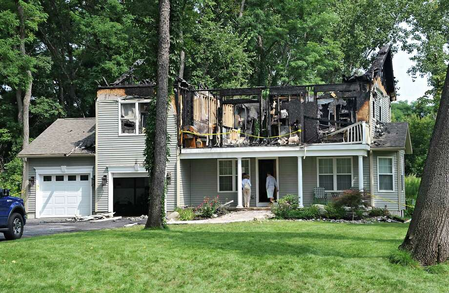 Scene at a fire-damaged home at 239 Mercer Ave. Wednesday, Aug. 20, 2014, in Rotterdam, N.Y. The fire occurred at 1 a.m. No one was injured. (Lori Van Buren / Times Union) Photo: Lori Van Buren / 00028259A