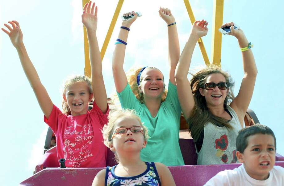 "Having the time of their lives aboard the ""Pirat"" during the 2014 Bridgewater Country Fair are, back, from left to right, Katie Hawley, 11, Kartyna Hook, 13, and Elizabeth Hawley, 14, of Bridgewater. Not so certain about their choice of recreation are, front, Morgan Neff, 7, of Newtown and Manny Santiago, 5, of East Haven. Aug. 16, 2014 Photo: Trish Haldin / The News-Times Freelance"