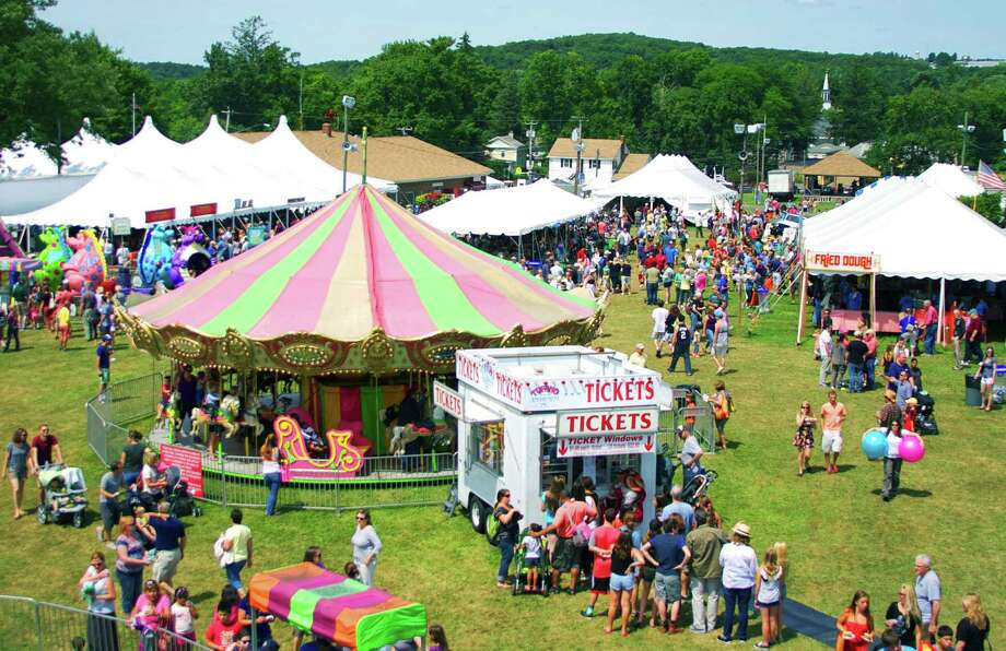 The view from the Ferris wheel during the 2014 Bridgewater Country Fair gives an observant patron an evocative panorama of the fair. Aug. 16,  2014 Photo: Trish Haldin / The News-Times Freelance