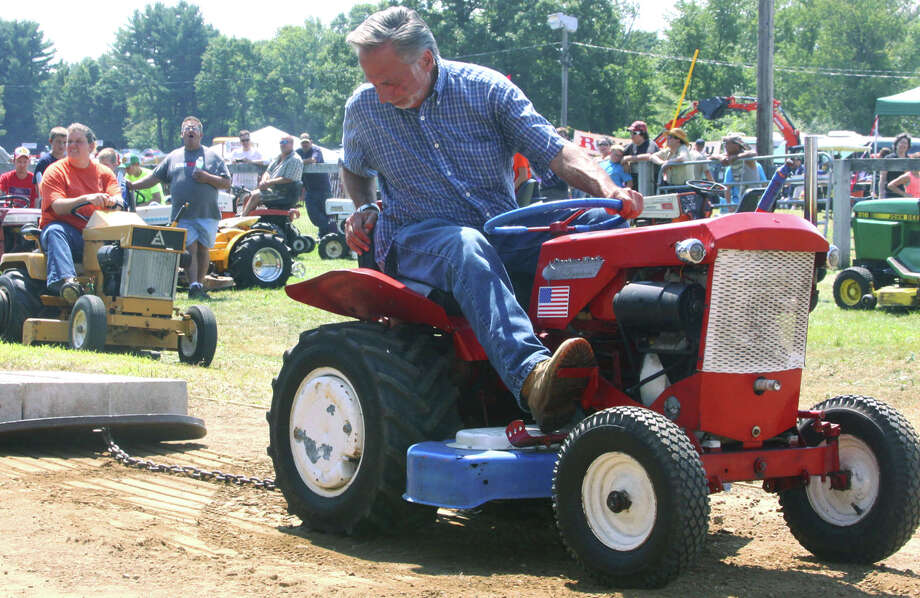 John Demchuk of Bridgewater focuses on the task at hand as he competes in the garden tractorpull during the 2014 Bridgewater Country Fair. Aug. 16,  2014 Photo: Walter Kidd / The News-Times Freelance