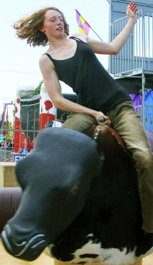 Sarah Scheub of Kent impresses onlookers with her bull-riding prowess during the 2014 Bridgewater Country Fair. Aug. 16,  2014 Photo: Walter Kidd / The News-Times Freelance