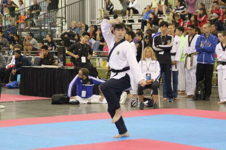 Darien native Michael Couloucoundis competes in the 2014 USA Taekwondo National Championship in early July, in San Jose, Calif. Photo: Contributed / Darien News Contributed