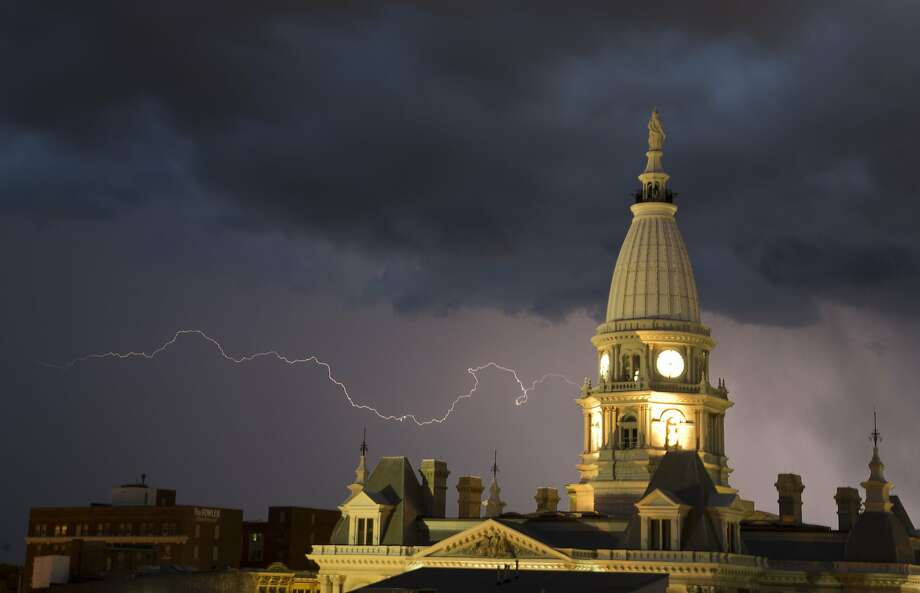 Meanwhile Doc is frantically hooking up a cable to the clock tower as Marty idles the DeLorean: Lightning strikes near the Tippecanoe County Courthouse in Lafayette, Ind. Photo: Michael Heinz, Associated Press