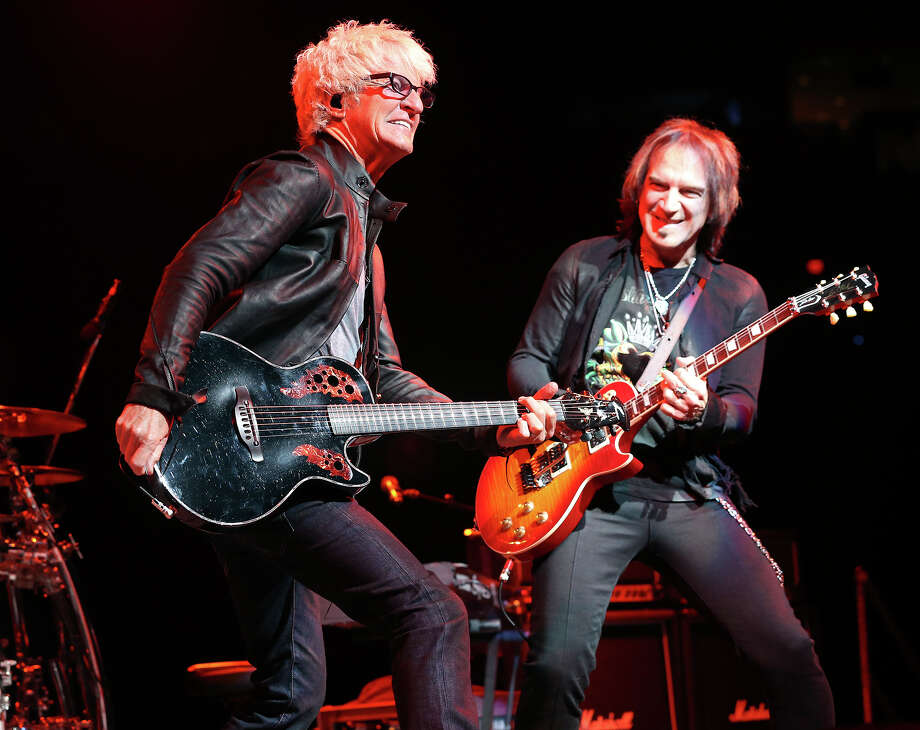 Kevin Cronin (left) leads his band REO Speedwagon as guitarist Dave Amato rocks after rodeo action at the AT&T Center on Friday, February 22, 2013. (San Antonio Express-News) Photo: TOM REEL / San Antonio Express-News