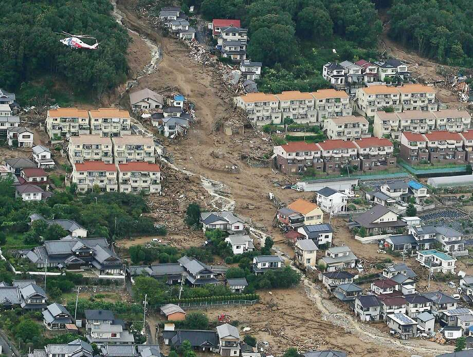 Deadly slide:An aerial view shows the damage caused by a landslide after heavy rains hit the Japanese city of Hiroshima. At least 18 people were killed and another 13 were still missing. Photo: Jiji Press, AFP/Getty Images