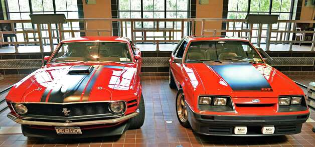 A 1970 Boss 302, left, and a 1985 Mustang 5.0 GT on display at the Saratoga Auto Museum Thursday June 19, 2014, in Saratoga Springs, NY.  (John Carl D'Annibale / Times Union) Photo: John Carl D'Annibale / 00027432A